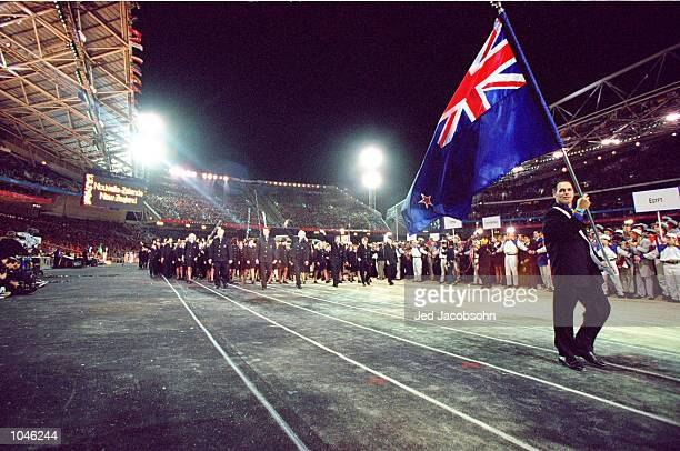 Flag Bearer and Equestrian competitor Blyth Tait leads round the New Zealand Olympic Team during the Opening Ceremony of the Sydney 2000 Olympic...