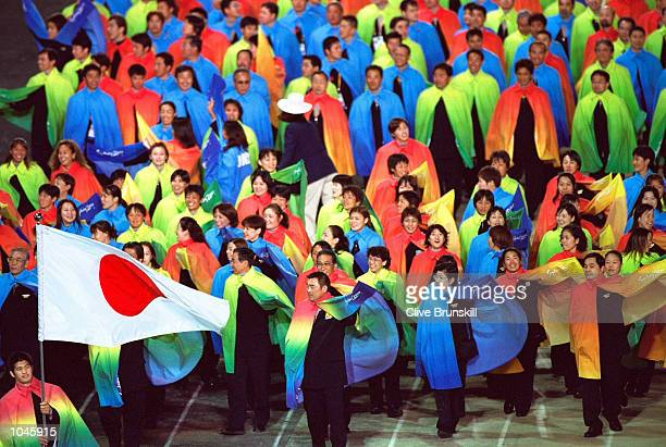 Flag Bearer Kosei Inoue leads team Japan during the Opening Ceremony of the Sydney 2000 Olympic Games at the Olympic Stadium in Homebush Bay, Sydney,...