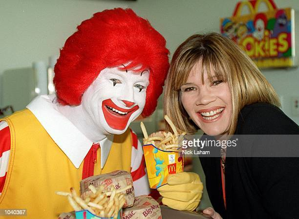 Former Australian swimmer Tracey Wickham with Ronald McDonald at the launch of the new McDonalds restaurant in the casual dining section of the...
