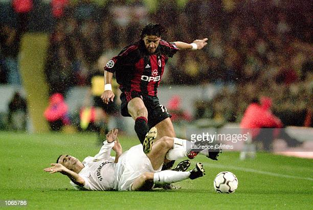 Francesco Coco of AC Milan is challenged during the UEFA Champions League match against Leeds United at Elland Road in Leeds England Leeds United won...