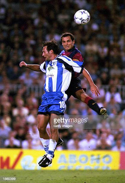 Francisco Rufete of Malaga and Barjuan Sergi of Barcelona in action during the Spanish Primera Liga match between Barcelona and Malaga at the Nou...