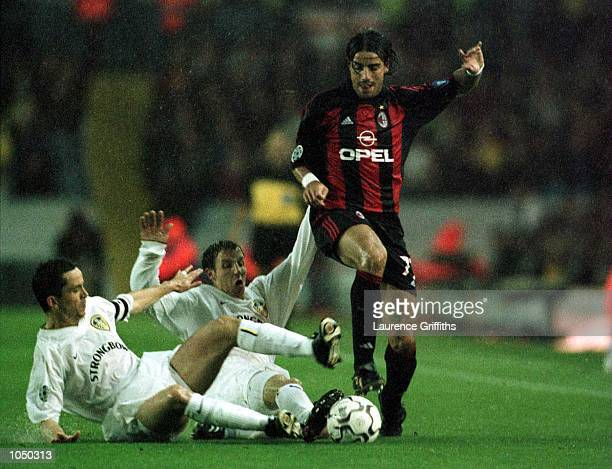 Gary Kelly and Lee Bowyer of Leeds United both try to tackle Francesco Coco of AC Milan during the match between Leeds United and AC Milan in the...