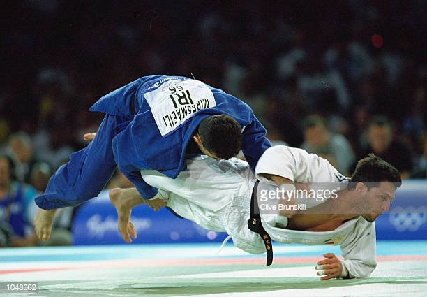 Girolamo Giovinazzo of Italy battles with Arash Miresmaeili of the Islamic Republic of Iran during the Mens 66kg Judo Bronze Medal bout on Day Two of...