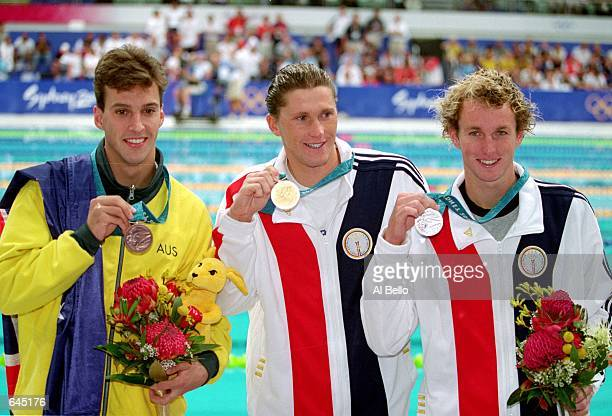 Gold Medal winner Lenny Krayzelburg of the USA poses with Silver Medal winner Aaron Peirsol of the USA and Bronze Medal winner Matthew Welsh of...