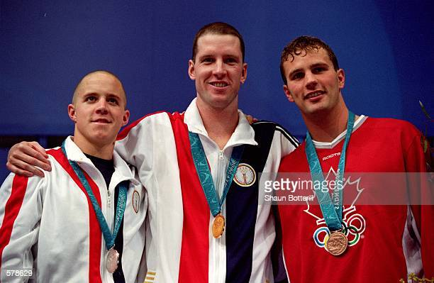 Gold Medal winner Tom Dolan of the USA poses with Silver Medal winner Erik Vendt of the USA and Bronze Medal winner Curtis Myden of Canada after the...