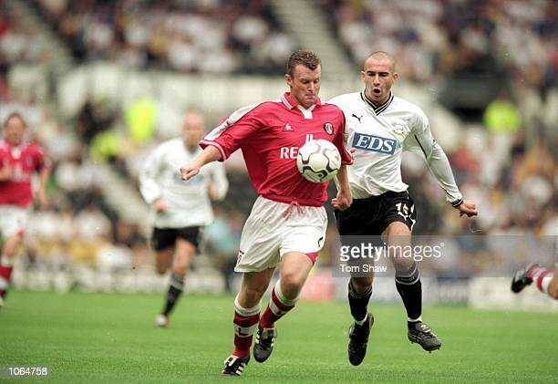 Graham Stuart of Charlton Athletic chests the ball while Danny Higginbotham of Derby County closes in during the FA Carling Premiership match at...