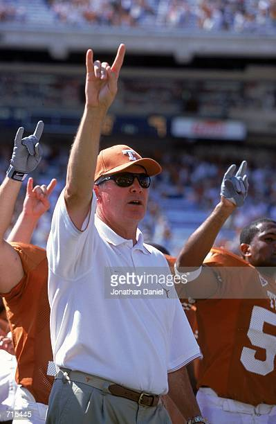 Head Coach Mack Brown of the Texas Longhorns celebrates on the sidelines during the game against the Oklahoma State Cowboys at the Royal-Memorial...