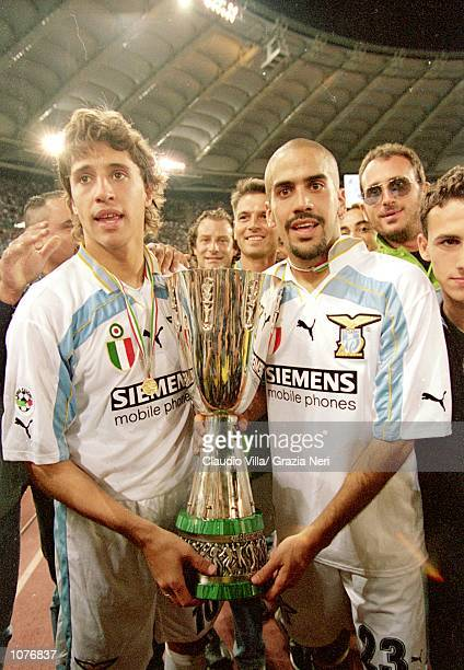 Hernan Crespo and Juan Sebastian Veron of Lazio hold the winning trophy after the Italian Super Cup match against Inter Milan played at the Stadio...