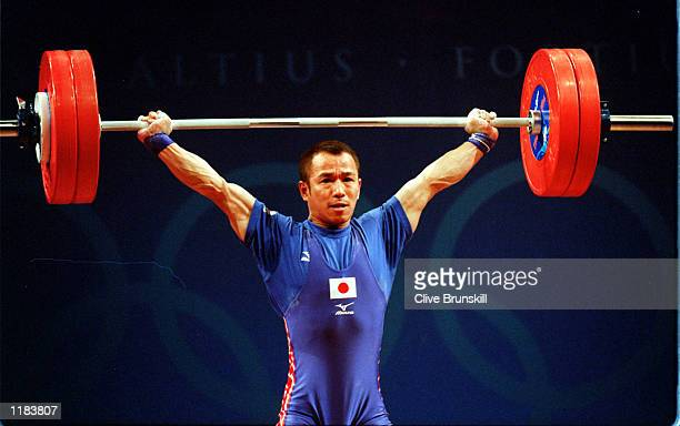 Hiroshi Ikehata of Japan lifts during the Mens 62 kilogram Weightlifting Snatch event at the Sydney Convention and Exhibition Centre in Darling...