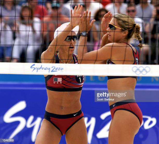 Holly McPeak and Misty May of USA celebrate after defeating Martina Hudcova and Tereza Tobiasova of Czech Republic during the Elimination Round of...