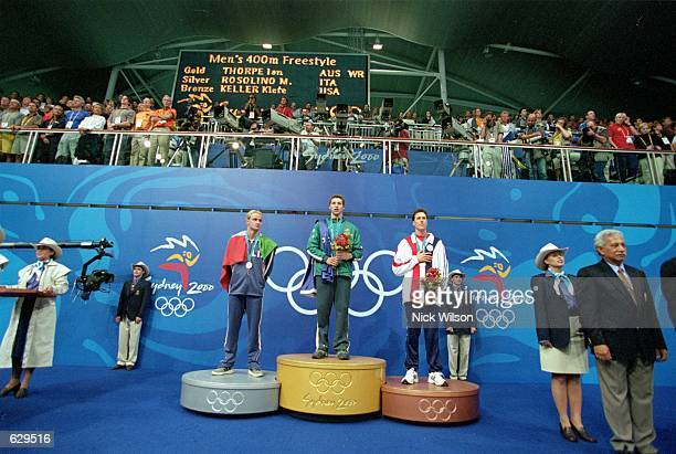 Ian Thorpe of Australia who set a new worlds record Mussimiliano Rosolino of Italy and Klete Keller of the USA pose on the medal stand after the...