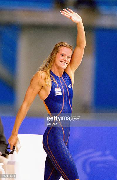 Inge De Bruijn of the Netherlands celebrates after winning Gold in the Womens 100m Butterfly Final in a new world record time of 5661 secs at the...