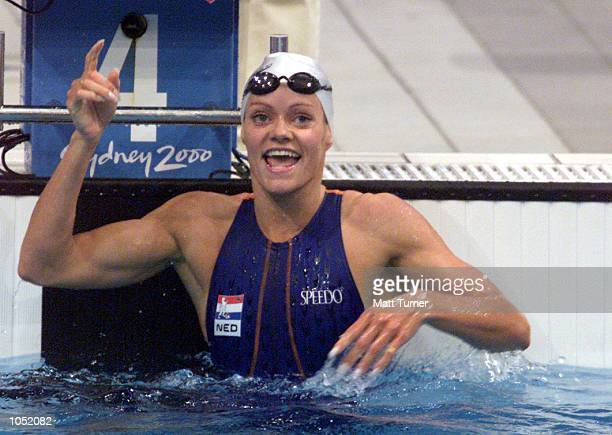 Inge de Bruijn of the Netherlands celebrates winning gold the final of the Women's 100m Freestyle at the Sydney 2000 Olympic Games held at the...