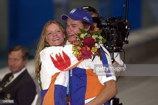 Inge de Bruijn of the Netherlands celebrates winning the Gold medal in a world record time of 5661 with a kiss after the Women's 100m Butterfly final...