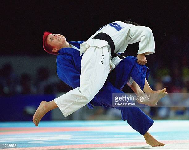 Ioana Maria Dinea of Romania battles with Sun Hui Kye of Korea in the Womens 52kg Judo bout at the Sydney Exhibition Centre during Day Two of the...