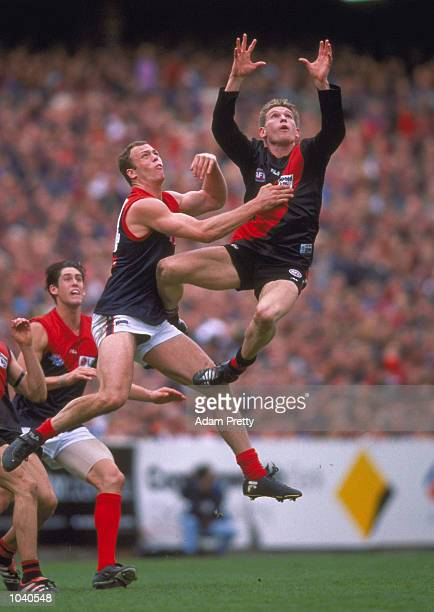James Hird for Essendon flies for the mark in front of Alistair Nicholson for Melbourne, in the AFL Grand Final match between the Essendon Bombers...