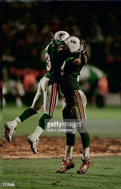 Jason Taylor of the Miami Dolphins gets hugged by teammate Patrick Surtain after the game against the Baltimore Ravens at Pro Player Stadium in Miami...