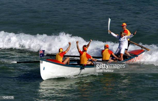 Jessie NileyDyer holds the torch aloft during the Torch Relay at Bondi Beach in preparation for the Sydney 2000 Olympic Games Sydney Australia...