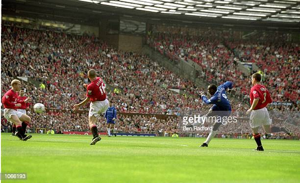 Jimmy Floyd Hasselbaink of Chelsea scores their first goal during the FA Carling Premiership match against Manchester United at Old Trafford in...