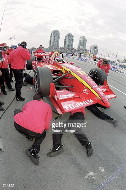 Jimmy Vasser of the USA who drives a Toyota/Lola 2KI for Target/Chip Ganassi Racing gets serviced in the pit lane during the Molson Indy Vancouver...