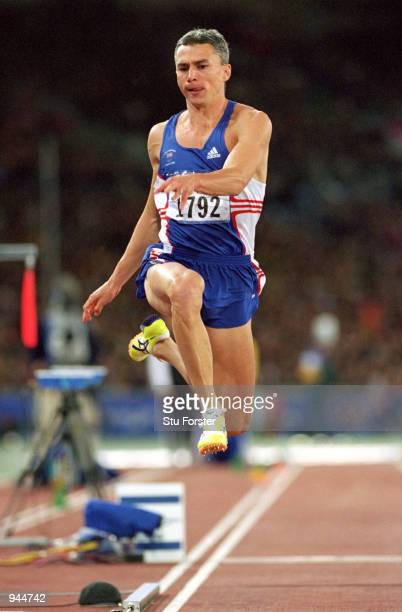 Jonathan Edwards of Great Britain on his way to gold in the Mens Triple Jump at the Olympic Stadium on Day 10 of the Sydney 2000 Olympic Games in...