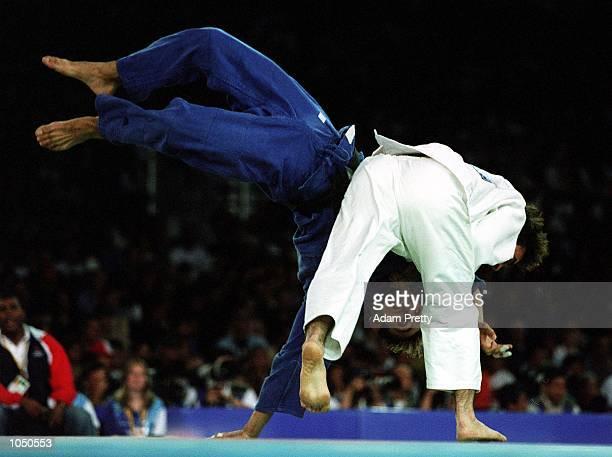 Jose Vicbart Geraldino Rossello of Dominican Republic throws Adrian Croitoru of Romania during the Mens 90 kilogram Judo event at the Sydney...