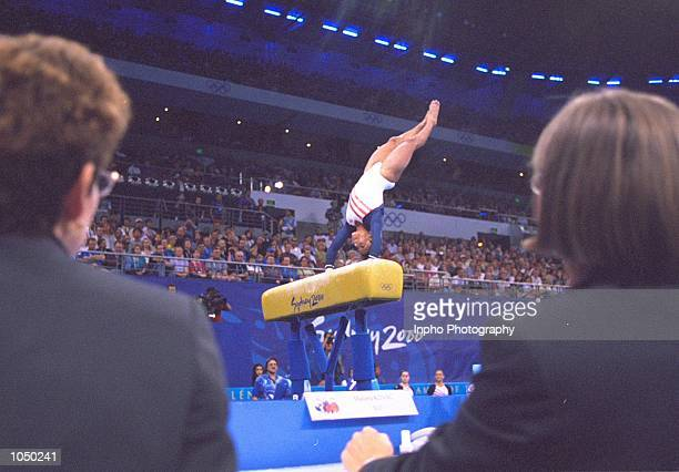 Judges watch Dominic Dawes of the USA in the Vault of the Womens Team Gymnastics at the Sydney Superdome on Day Four of the Sydney 2000 Olympic Games...