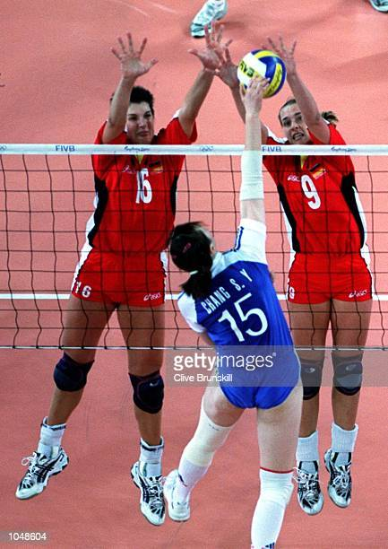 Judith Sylvester and Christina Benecke of Germany combine to return the ball to So Yun Chang of Korea during the womens Volleyball preliminaries at...