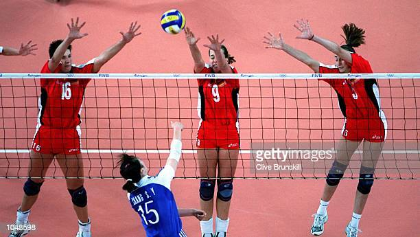 Judith Sylvester Christina Benecke and Sylvia Roll of Germany combine to return the ball to So Yun Chang of Korea during the womens Volleyball...