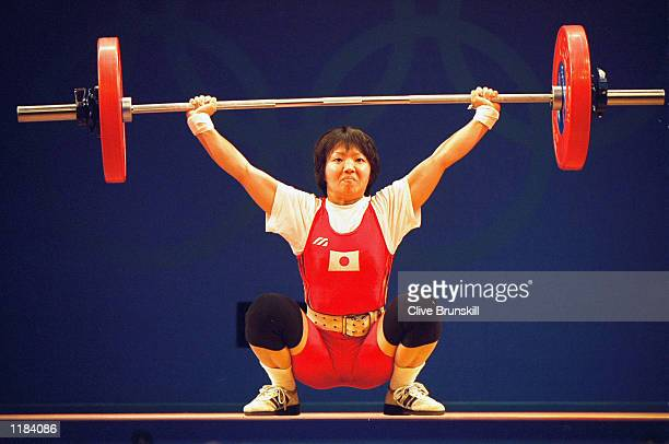 Kaori Niyanagi of Japan in action in the Women's 48kg Weightlifting event at the Convention Centre in Darling Harbour on Day Two of the Sydney 2000...