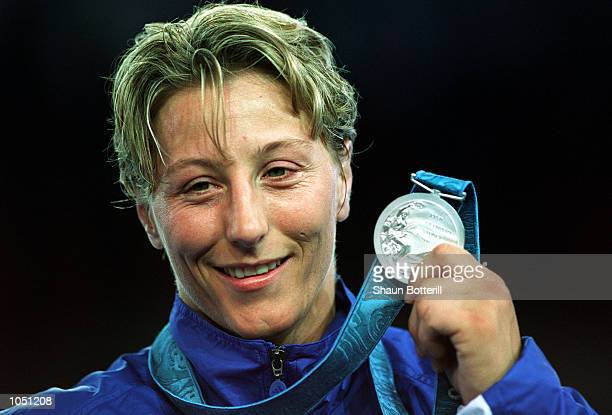 Kate Howey of Great Britain celebrates with her silver medal in the womens 70 kilogram Judo event at the Sydney Convention and Exhibition Centre in...