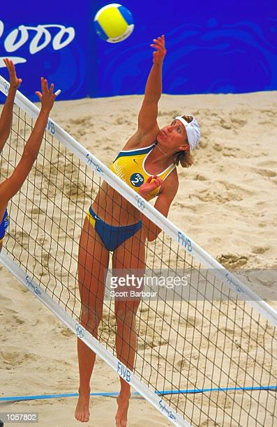 Kerri Pottharst of Australia spikes during the Womens Beach Volleyball Final at Bondi Beach on Day Ten of the Sydney 2000 Olympic Games in Sydney...