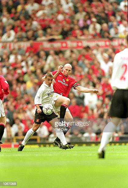 Kevin Phillips of Sunderland shrugs off Jaap Stam of Manchester United during the FA Carling Premiership match at Old Trafford in Manchester England...