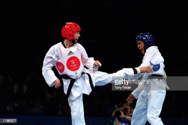 Lauren Burns of Australia and Urbia Melendez Rodriguez of Cuba in action during the Women's 49kg Taekwondo Final held at the State Sports Centre...