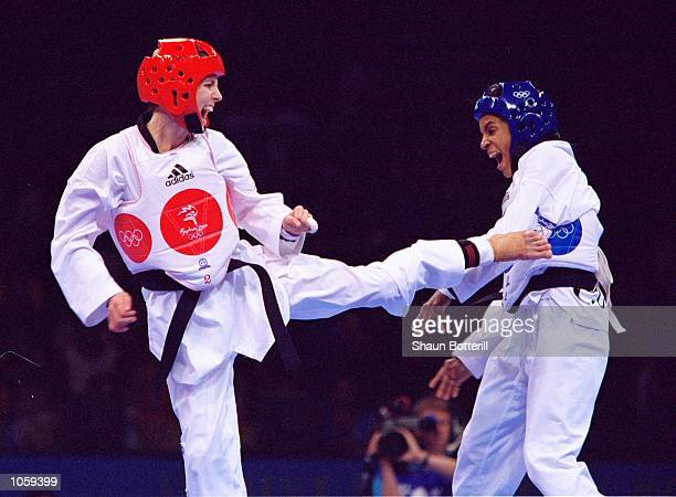 Lauren Burns of Australia attacks Urbia Melendez Rodriguez of Cuba in the Womens 49kg Taekwondo Finals at the State Sports Centre on Day 12 of the...