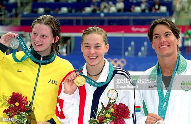 Leisel Jones of Australia poses with Gold Medal winner Megan Quinn of the USA and Silver Medal winner Penny Kleyns of South Africa Event after the...