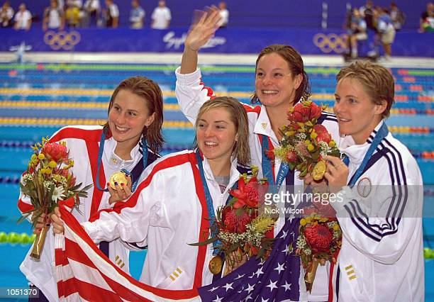 Lindsay Benko Diana Munz Samanthe Arsenault and Jenny Thompson of the USA win Gold in the Womens 4 x 200m Freestyle Final at the Sydney Aquatic...