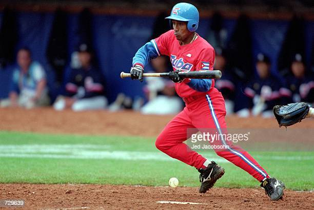 Luis Ulacia of Cuba bunts the ball during the Men's Baseball Semifinal game against Japan at the Blacktown Olympic Centre for the 2000 Sydney...