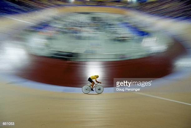 Luke Roberts of Australia rides in the Men's 4000M Individual Pursuit Cycling race during the Sydney Olympic Games at the Dunc Gray Velodrome in...
