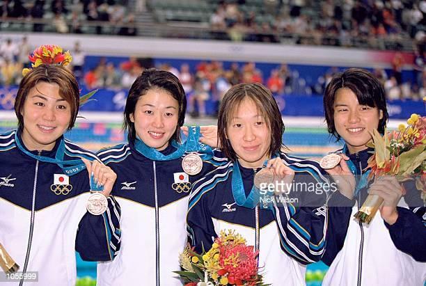 Mai Nakamura Masami Tanaka Junko Onishi and Sumika Minamoto of Japan win Bronze in the Womens 4 x 100m Medley Relay Final at the Sydney International...