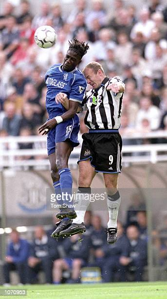 Mario Melchiot of Chelsea wins the ball in the air against Alan Shearer of Newcastle United during the FA Carling Premiership match played at St...
