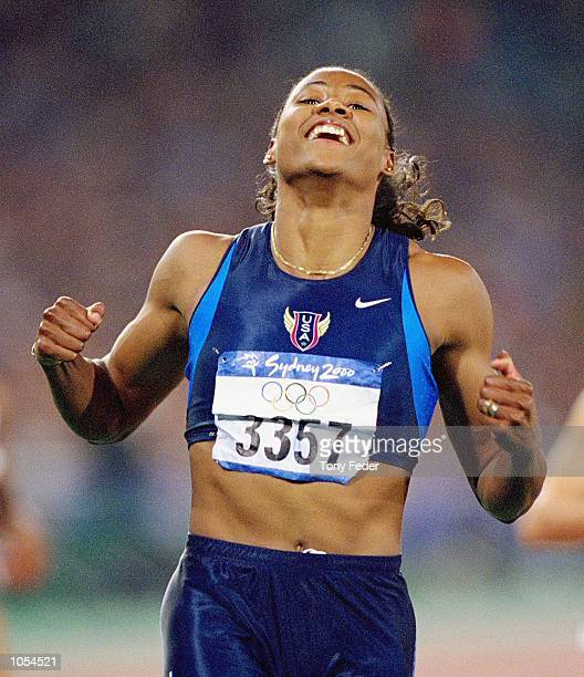 Marion Jones of the USA wins the Women's 100m Final at the Olympic Stadium on Day Eight of the Sydney 2000 Olympic Games in Sydney Australia...