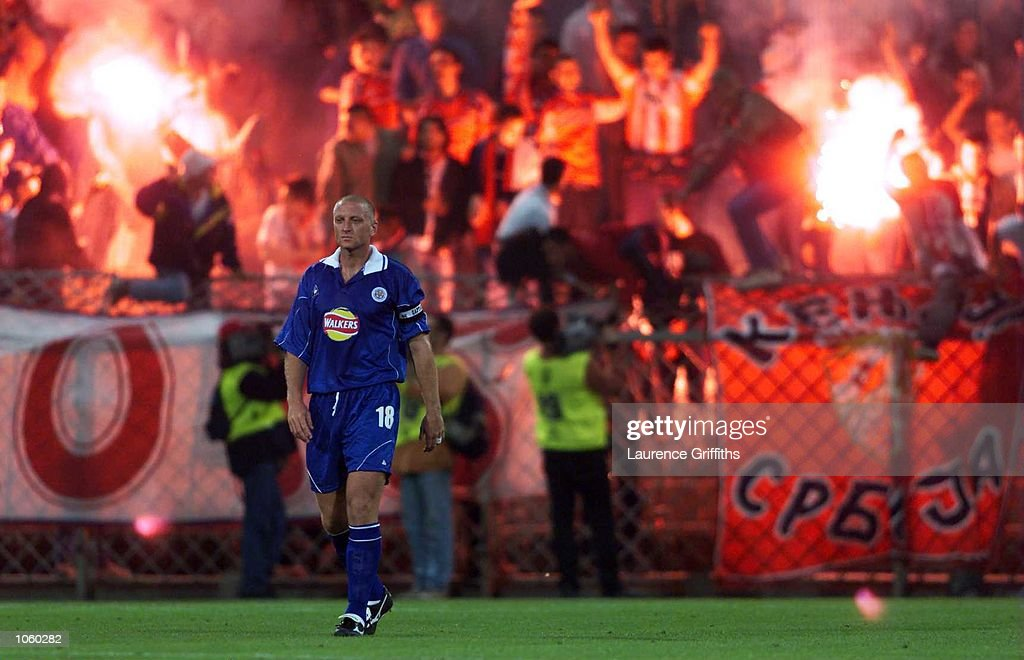 Matt Elliott of Leicester City looks dejected as the Red Star fans celebrate their goal during the UEFA Cup 1st round second leg game between Leicester City and Red star Belgrade at the Gerhard Hanapi Stadium in Vienna, Austria. Mandatory Credit: Laurence Griffiths/ALLSPORT