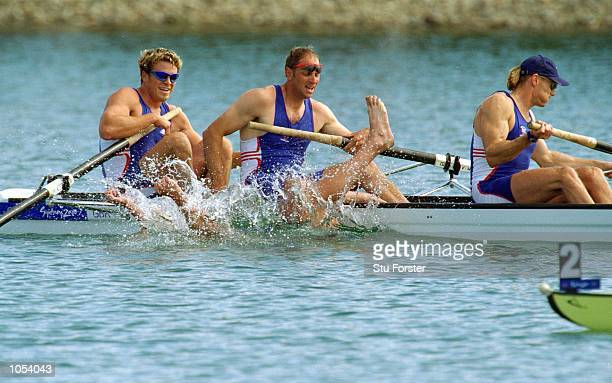 Matthew Pinsent falls into the water whilst celebrating gold in the Men's Coxless Four Rowing Final alongside Great Britain team mates James...