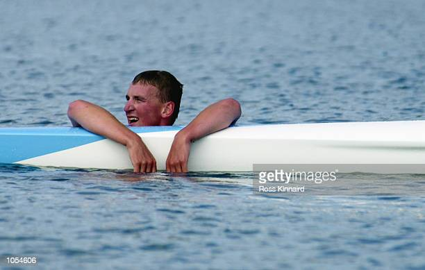 Matthew Pinsent of Great Britain in the water after winning gold in the Men's Coxless Four Rowing Final at the Sydney International Regatta on Day...