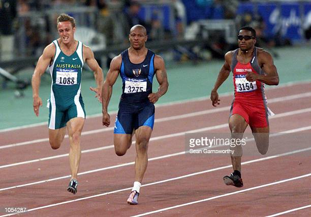 Maurice Greene of the USA on his way to victory as Matt Shirvington of Australia and ASto Boldon of Trinadad chase him down in the mens 100m semi...