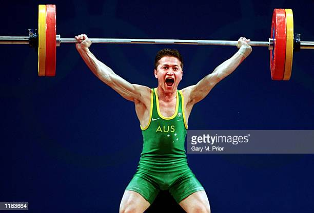 Mehmet Yagci of Australia in action during the 56 kilogram Snatch Weightlifting event at the Sydney Convention and Exhibition Centre during the...