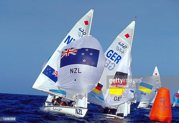 Melinda Henshaw and Jenny Egnot of New Zealand and Nicola Birkner and Wibke Buelle of Germany in action in the Women's 470 Sailing Fleet Races at...
