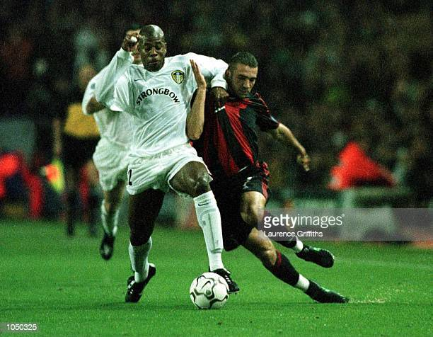 Michael Duberry of Leeds United holds off Andrei Shevchenko of AC Milan during the match between Leeds United and AC Milan in the Champions League...