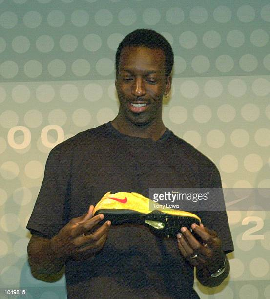 Michael Johnson at a press conference in the Nike Media Centre in Sydney where his gold shoes for the Sydney 2000 Olympic Games were unveiled....